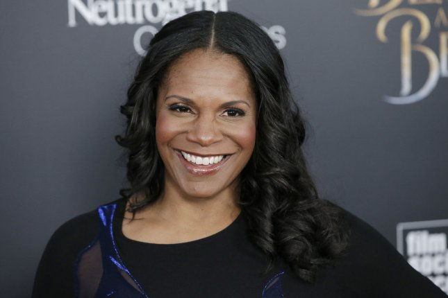 Audra McDonald arrives on the red carpet at the Beauty and the Beast New York screening on March 13. The actress is set to co-star in Season 2 of The Good Fight. File Photo by John Angelillo/UPI
