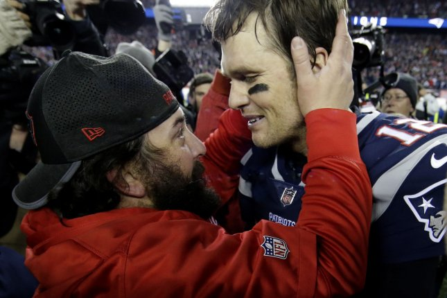 Former New England Patriots defensive coordinator and current Detroit Lions head coach Matt Patricia (L) hugs winning Patriots quarterback Tom Brady in the AFC Championship Game on January 21, 2018 at Gillette Stadium in Foxborough, Massachusetts. Photo by John Angelillo/UPI