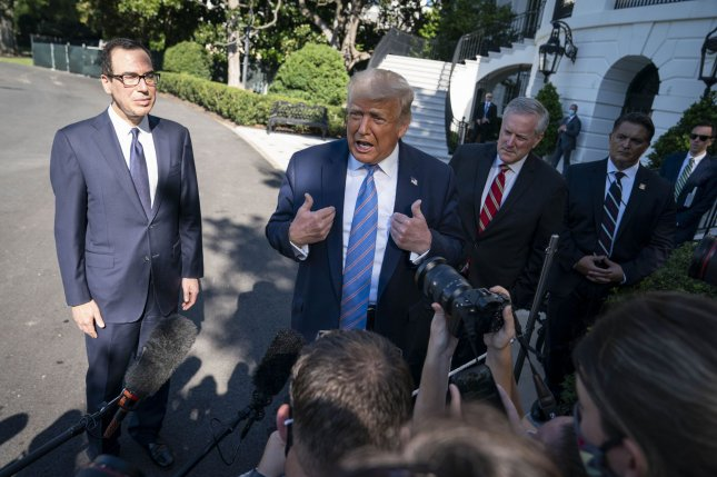 U.S. President Donald Trump speaks to the press along with Secretary of the Treasury Steven Mnuchin (L) and White House chief of staff Mark Meadowsoutside the White House in Washington, D.C., on Wednesday. Photo by Sarah Silbiger/UPI