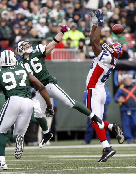 Terrell Owens goes up for a pass against the New York Jets on Oct. 18, 2009. UPI Photo /John Angelillo