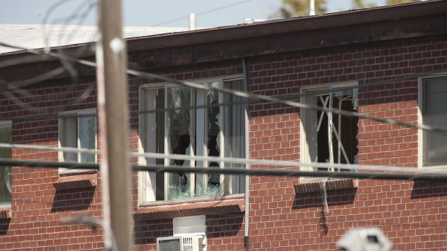 The alleged gunman's third floor apartment's windows were broken to allow video to be taken of the booby trapped interior after twelve movie goers were shot and killed with 58 injured at the Century 16 movie theaters at the Aurora Mall in Aurora, Colorado on July 20, 2012. The victims were attending a midnight premiere of the new Batman movie. The suspect, James Holmes, allegedly threw a smoke bomb and opened fire on the moviegoers. He surrendered to police and is currently in custody. UPI/Gary C. Caskey