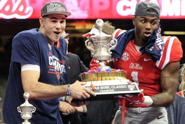 Mississippi Rebels quarterback Chad Kelly (L) and wide receiver Laquon Treadwell hold the Sugar Bowl trophy after deafeating the Oklahoma State Cowboys at the Allstate Sugar Bowl at the Mercedes-Benz Superdome in New Orleans, Louisiana, on January 1, 2016. Photo by A.J. Sisco/UPI