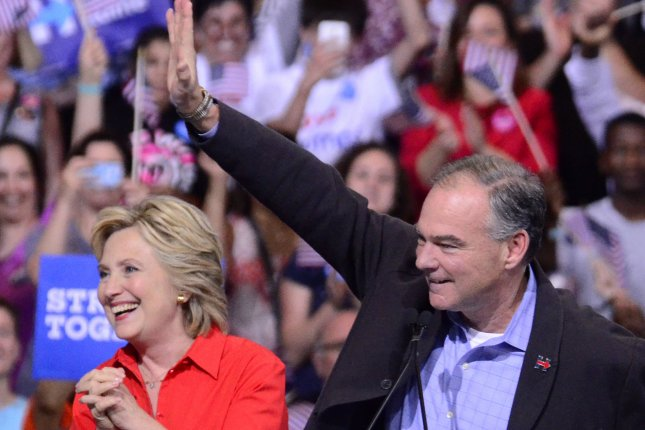 Democratic presidential candidate Hillary Clinton and runningmate Sen. Tim Kaine take the stage at a rally in Pittsburgh as part of their bus tour following the Democratic Convention on Saturday. The UPI/Cvotr daily tracking poll shows Clinton continues to enjoy post-convention bump. Photo by Archie Carpenter/UPI