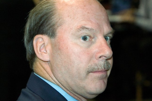 Mike Keenan, former head coach of the Florida Panthers walks to the podium during the first round of the 2006 NHL entry draft being held at Vancouver's GM Place, June 24, 2006. (UPI Photo/Heinz Ruckemann)