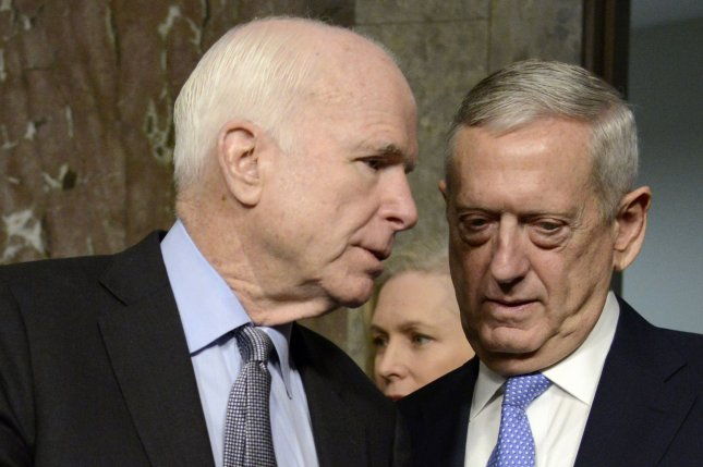 Sen. John McCain (L), R-Ariz., at the confirmation hearing of Gen. James Mattis (R), now secretary of defense. McCain and U.S. Sen. Ted Cruz, R-Texas, are the target of North Korea's latest verbal attacks. File Photo by Mike Theiler/UPI