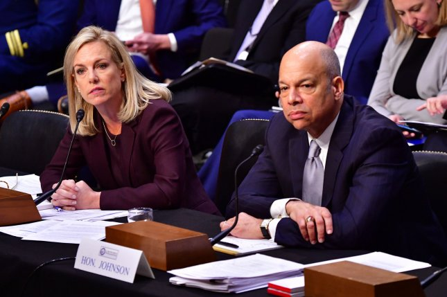 Homeland Security Secretary Kirstjen.Nielsen (L) and former Homeland Security Secretary Jeh Johnson testify during a Senate intelligence hearing on election security on Capitol Hill in Washington, D.C., on Wednesday. Photo by Kevin Dietsch/UPI