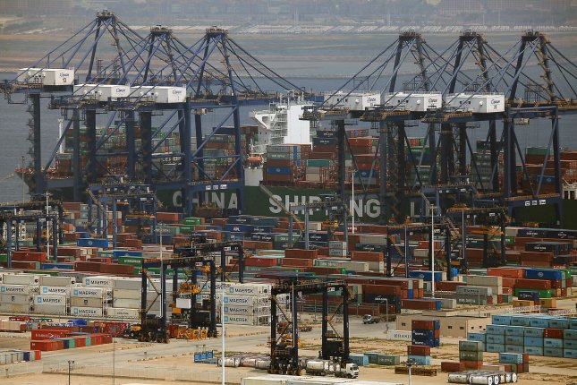 A commercial container ship is loaded by a row of dockside gantry cranes in Dalian, a major Chinese port city in Liaoning Province, on July 20, 2018. The U.S. Treasury Department sanctioned two Chinese shipping companies for violating international sanctions against North Korea. File Photo by Stephen Shaver/UPI