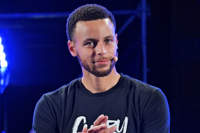 Golden State Warriors guard Stephen Curry frequently crosses over opposing defenders, but was recently on the receiving end of a deceptive dribble move at his high school basketball camp this week in the Bay Area of California. File Photo by Keizo Mori/UPI
