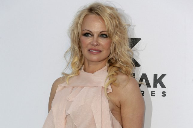 Pamela Anderson and A Star is Born producer Jon Peters exchanged vows at secret wedding in Malibu, Calif. File Photo by Sven Hoogerhuis/UPI