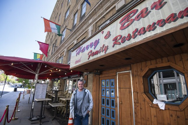 John Boyle stands Wednesday outside his popular Harry's Bar and Restaurant that is now closed in Washington, D.C., due to the coronavirus crisis. Photo by Pat Benic/UPI