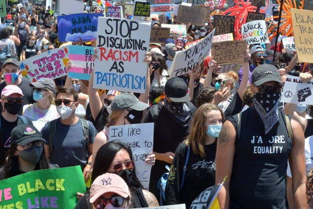 Demonstrators rally against racial injustice and in support of gay rights on Sunday in Los Angeles. Photo by Jim Ruymen/UPI