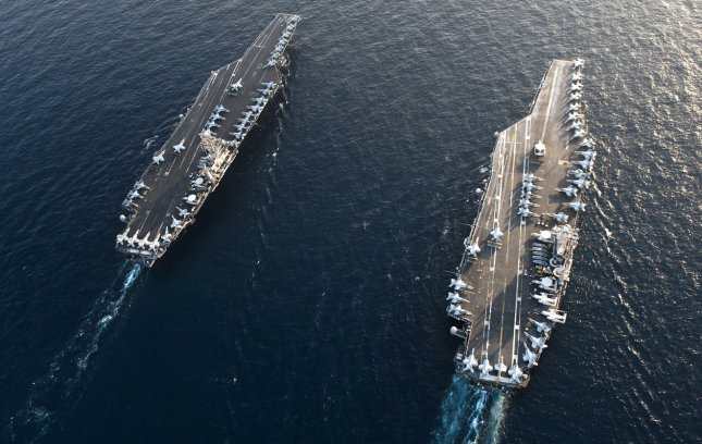 The Nimitz-class aircraft carriers USS John C. Stennis (CVN 74) and USS Abraham Lincoln (CVN 72) transit during a turnover of responsibility in the Arabian Sea on January 19, 2012. The USS Lincoln transited through the Strait of Hormuz without incident on January 22, 2012. The EU banned oil purchases from Iran on January 23, 2011. Iran has said it may blockade the Strait of Hormuz, but the U.S. Fifth Fleet has said it will not allow this to happen. UPI/Kenneth Abbate/U.S. Navy
