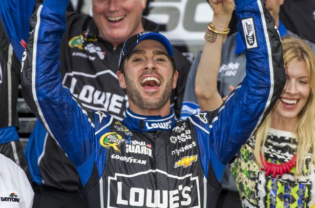 6f10b1d2b99 Jimmie Johnson lifts the trophy in Gatorade Victory Lane after winning the Daytona  500 in his #9 Lowes Chevrolet at Daytona International Speedway in ...