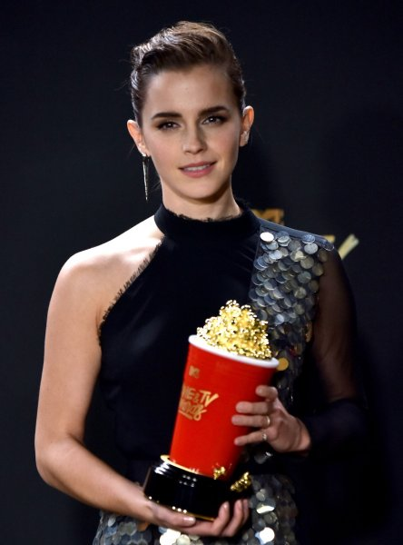 Actress Emma Watson appears backstage with the Best Actor in a Movie award for her performance in Beauty and the Beast during the MTV Movie & TV Awards at the Shrine Auditorium in Los Angeles on May 7. Photo by Christine Chew/UPI