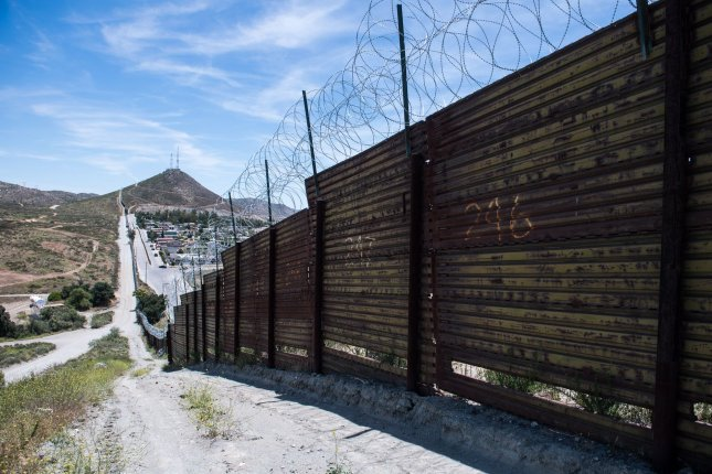 A section of security fence is seen June 10 on the U.S.-Mexico border in Tecate, California. File Photo by Kevin Dietsch/UPI