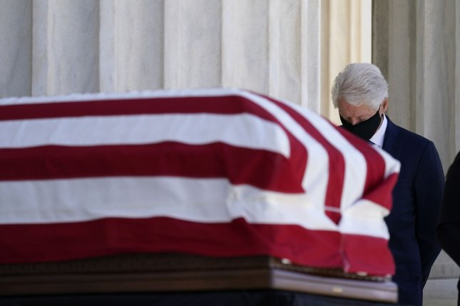 Former President Bill Clinton pays respects Wednesday as Justice Ruth Bader Ginsburg lies in repose under the Portico at the top of the front steps of the U.S. Supreme Court building in Washington, D.C. Pool Photo by Alex Brandon/UPI