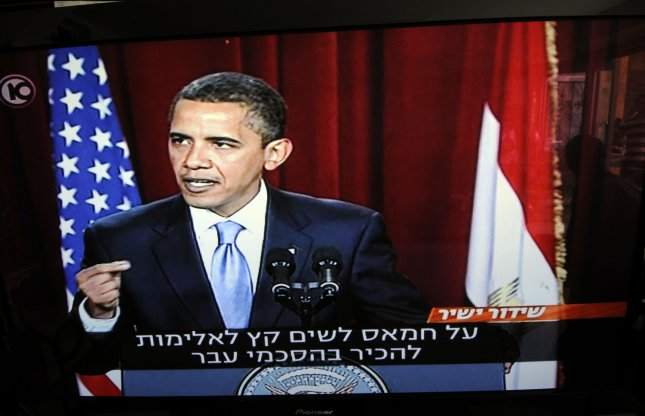 Israelis watch a live broadcast of U.S. President Barak Obama's speech to the Muslim world from Cairo University on televisions in an appliance shop in Jerusalem, June 4, 2009. President Obama's speech is translated into Hebrew on the Israeli channel. (UPI Photo/Debbie Hill)