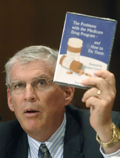 Executive Director of Families USA Ron Pollack holds up a DVD about Medicare Part D and prescriptions options as he testifies before a Senate Democratic Policy Committee hearing on Medicare Part D, in Washington. An estimated more than 2 million U.S. seniors who would qualify for a subsidy -- free money -- under Medicare Part D, failed to apply. (UPI Photo/Kevin Dietsch).