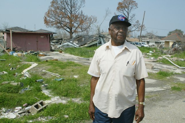 Herbert Warren stands in his yard in the Lower 9th Ward of New Orleans. Warren was in the area to watch as his home was demolished March 6, 2006. Warren's home was the first of 120 homes to be bulldozed in the aftermath of Hurricane Katrina, which collapsed levees in the area last year and flooded 80 percent of city. (UPI Photo/A.J. Sisco)
