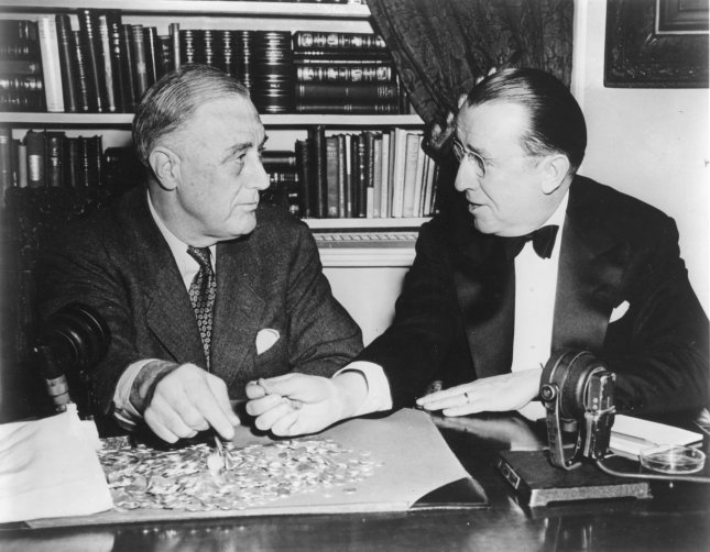 U.S. President Franklin D. Roosevelt (L), who founded the March of Dimes to fight polio Jan. 3, 1938, is shown at the White House in an undated file photo with Basil O'Connor, who worked with the president in forming the charity. (Note the dimes on the desk.) The mission of the foundation started by FDR, who had polio, eventually changed its focus to premature births and birth defects. March of Dimes Photo/UPI/File