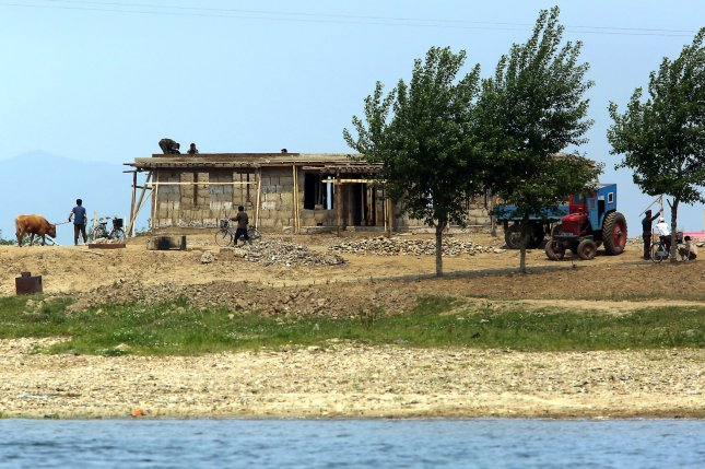 North Koreans construct a small building on the banks of the Yalu River near Sinuiju, across the Yalu from Dandong, China's largest border city with North Korea. A former U.N. human rights commisioner said North Korea's caste system discriminates against its own population, and is a new example of apartheid. File Photo by Stephen Shaver/UPI