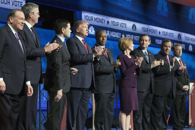 From left, Gov. Mike Huckabee, Gov. Jeb Bush, Sen. Marco Rubio, Donald Trump, Dr. Ben Carson, Carly Fiorina, Sen. Ted Cruz, Gov. Chris Christie, and Sen. Rand Paul arrive for the third Republican Party presidential candidates' debate Wednesday at the Coors Event Center on the campus of the University of Colorado in Boulder, Colo. Photo by Gary C. Caskey/UPI