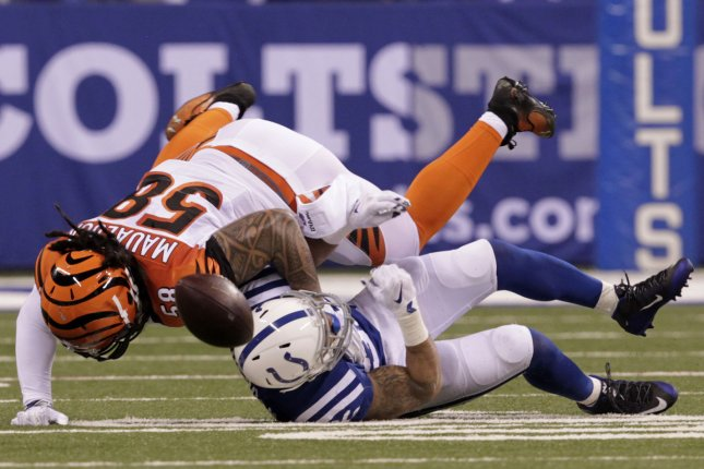 Cincinnati Bengal's Rey Maualuga (58) breaks up the pass to Indianapolis Colts' Daniel Herron (36). Photo by John Sommers II/UPI