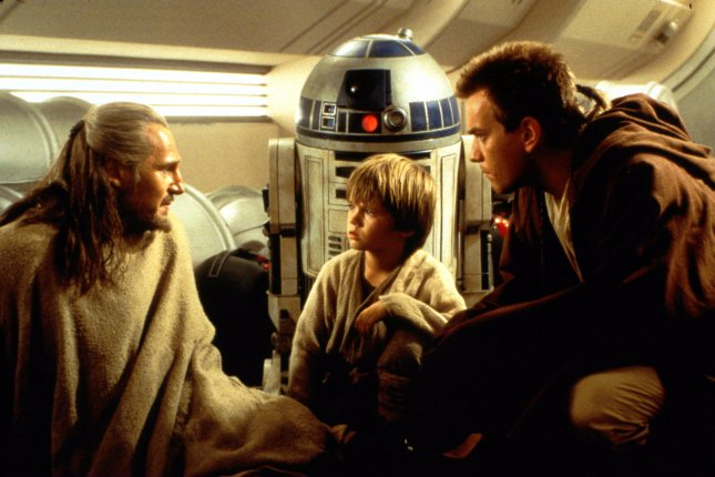 Jedi Master Qui-Gon Jinn (Liam Neeson), Anakin Skywalker (Jake Lloyd), and Jedi apprentice Obi-Wan Kenobi (Ewan McGregor) as R2-D2 listens in this scene from Star Wars: Episode I The Phantom Menace. The Charity Commission for England and Wales ruled the real-life group the Temple of the Jedi Order was not eligible for charitable status as a religion. File Photo by Keith Hamshere/Lucasfilm/UPI
