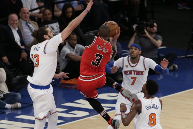 New York Knicks' Joakim Noah and Carmelo Anthony watch and Chicago Bulls' Dwyane Wade drive to the basket in the second half at Madison Square Garden in New York City on January 12, 2017. The Knicks defeated the Bulls 106-89. Photo by John Angelillo/UPI