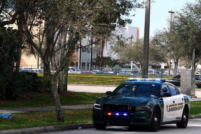 Broward County Sheriff's Office guard Marjory Stoneman Douglas High School in Parkland, Fla., on February 15, one day after a former student is in custody in the killing of 17 students and teachers. At least three deputies reportedly waited outside the school during the shooting. Photo by Gary Rothstein/UPI