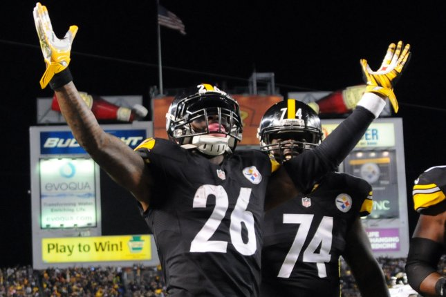 Pittsburgh Steelers running back Le'Veon Bell (26) celebrates his 11-yard touchdown run in the second quarter against the Baltimore Ravens on October 1, 2015 at Heinz Field in Pittsburgh. File photo by Archie Carpenter/UPI