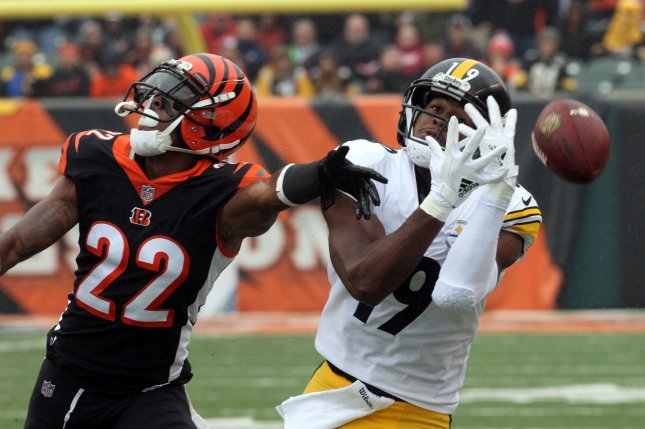 Cincinnati Bengals cornerback Williams Jackson (22) breaks up the pass to Pittsburgh Steelers wide receiver JuJu Smith-Schhuster (19) during the first half of play on October 14 at Paul Brown Stadium in Cincinnati. Photo by John Sommers II /UPI