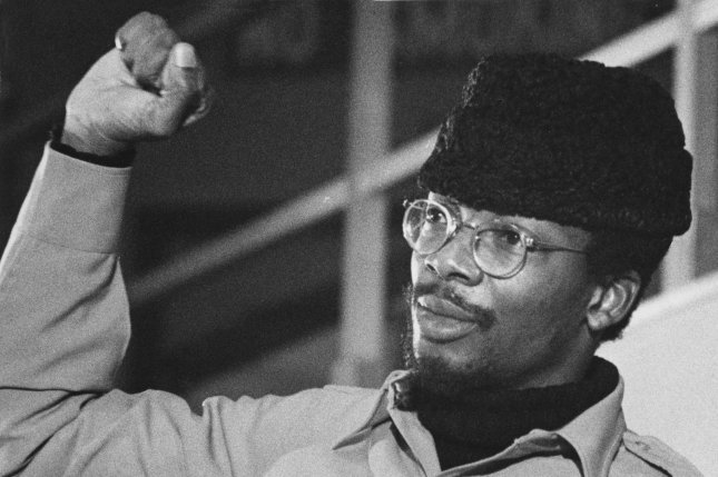 Black Panther Chairman Mesia Hewett gives the black power sign at a panel discussion at Boston College on December 8, 1969 in Boston. File photo by UPI