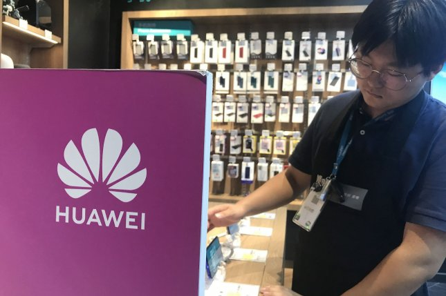 A shopper looks at Huawei smartphones at a store in Beijing, China, on August 21. File Photo by Stephen Shaver/UPI