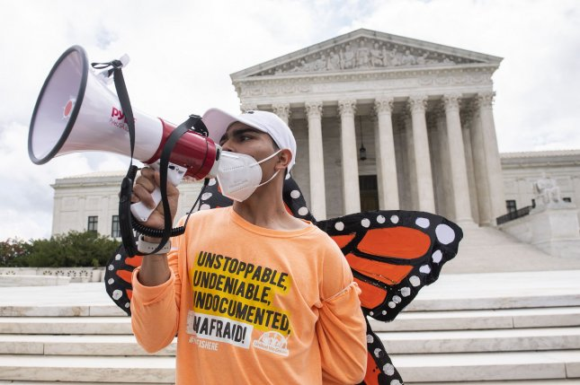 Immigration advocates rally outside the Supreme Court Thursday following a ruling in favor of the Deferred Action for Childhood Arrivals' (DACA) in Washington, D.C.Photo by Kevin Dietsch/UPI