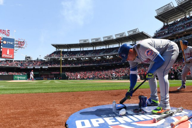 New York Mets infielder Asdrubal Cabrera warms up with Washington Nationals starting pitcher Stephen Strasburg on the mound to start the home opener of the Nats on April 5 at Nationals Park in Washington, D.C. Photo by Pat Benic/UPI