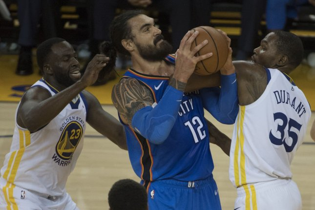 sneakers for cheap 442c9 63e66 Oklahoma City Thunder center Steven Adams (12) tries to force up a shot  between Golden State Warriors forward Draymond Green (23) and Kevin Durant ( 35) in ...