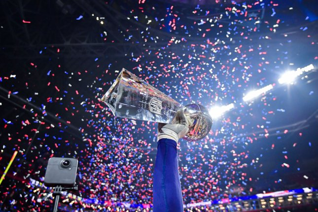The New England Patriots hoist the Vince Lombardi trophy Sunday after they defeated the Los Angeles Rams 13-3 in Super Bowl LIII at Mercedes-Benz Stadium in Atlanta, Ga. Photo by Kevin Dietsch/UPI