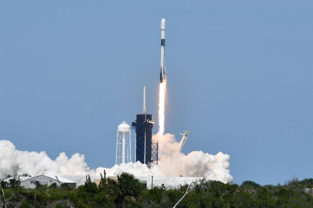 A SpaceX Falcon 9 rocket lifts off at 3:30 p.m. EDT Wednesday from Kennedy Space Center in Florida carrying 60 Starline communications satellites. Photo by Joe Marinol/UPI