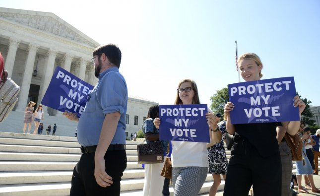 Demonstrators march in front of the Supreme Court, on its final day in session, on Capitol Hill on Thursday, June 27, 2019 in Washington, DC. Photo by Mike Theiler/UPI