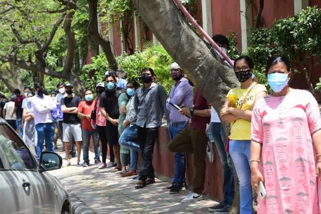 People wait for hours to receive COVID-19 vaccine doses at one of the largest vaccination sites at Radhaswami Satsang in New Delhi, India, in May. The World Health Organization said Monday that 11 billion vaccine doses are needed to end the pandemic by next June. File Photo by Abhishek/UPI