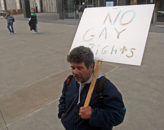 Mark Wassberg, of Richmond California, protests gay marriage outside the Federal Building where a federal trial over California's ban on same-sex marriage started in San Francisco, California, on January 11, 2010. UPI/David Yee