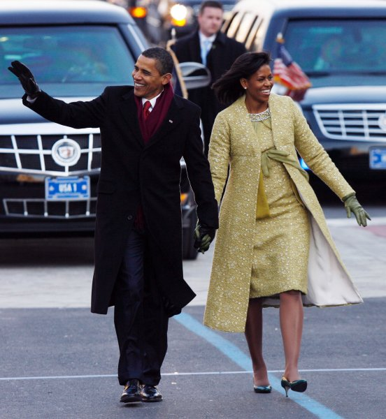U.S. President Barack Obama and First Lady Michelle Obama wave while walking the parade route after the Inauguration Ceremony on Capitol Hill in Washington on January 20, 2009. (UPI Photo/John Angelillo)