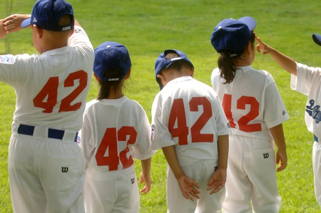 Little league baseball players (File/UPI Photo/Kevin Dietsch)