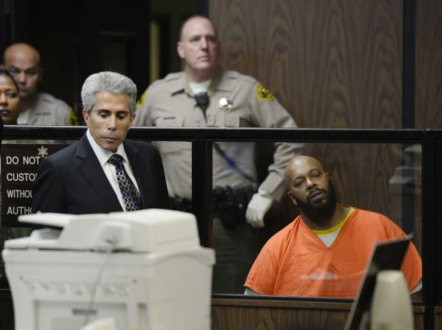 Former rap mogul Marion Suge'' Knight pleads not guilty to charges of murder, attempted murder and hit-and-run for allegedly running down two men in Compton, killing one and injuring the other during his arraignment at the Compton Courthouse in Compton, California on February 3, 2015. At left is his attorney David Kenner. Photo by Paul Buck/UPI/pool