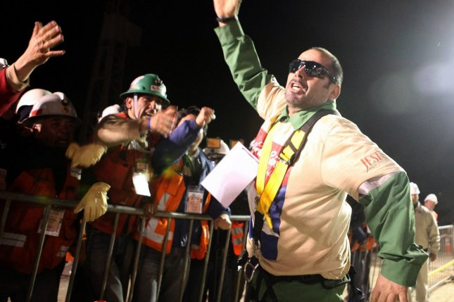 Chilean miner Mario Sepulveda, 39, waves to workers and well-wishers as he is the second miner to be rescued from the San Jose Mine near Copiapo, Chile just after midnight on Oct. 13, 2010. File Photo by UPI/Chilean Government/HO