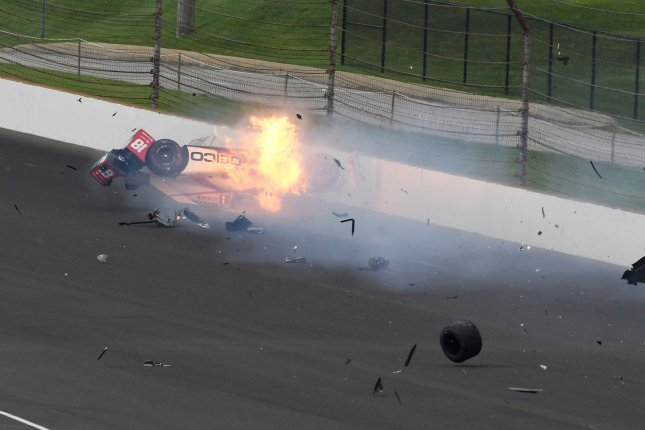 Sebastien Bourdais' race car bursts into flames after slamming the turn 2 wall during qualifications at the Indianapolis Motor Speedway on May 20, 2017 in Indianapolis, Indiana. Bourdais was transported to Methodist Hospital with a multiple fractures to his pelvis and right hip. Photo by Larry Papke/UPI