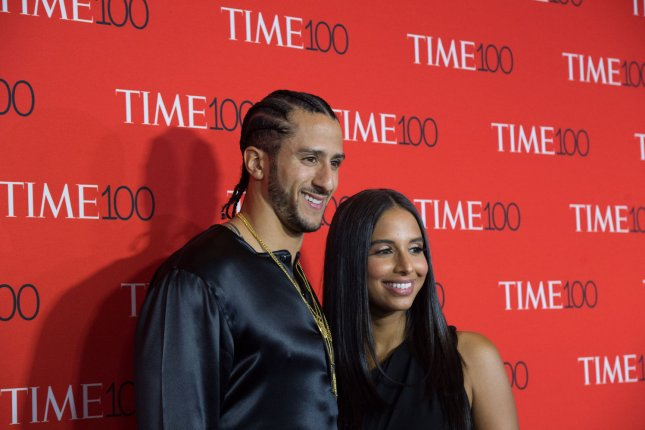 Colin Kaepernick and Nessa arrive on the red carpet at the TIME 100 Gala at Frederick P. Rose Hall, Home of Jazz at Lincoln Center, in New York City on April 26. The football player turns 30 on November 3. File Photo by Bryan R. Smith/UPI