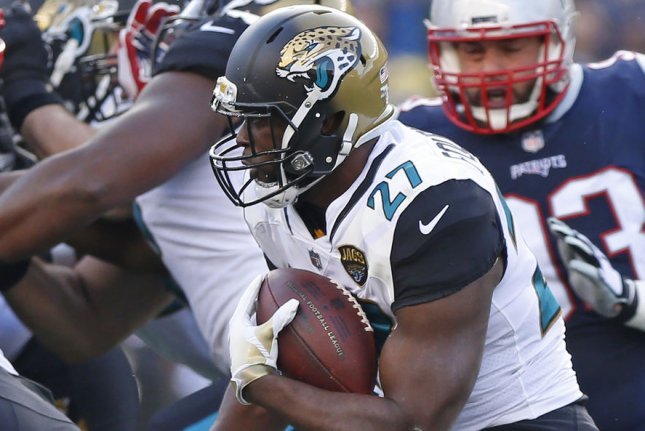 Jacksonville Jaguars running back Leonard Fournette fights for yardage during the AFC Championship game against the New England Patriots last season. Photo by Matthew Healey/ UPI