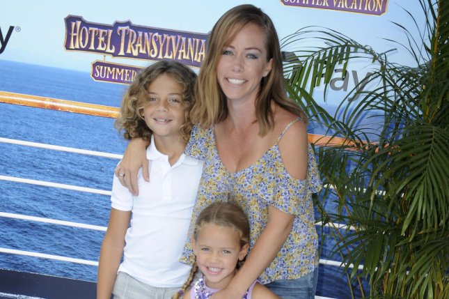Kendra Wilkinson (R), pictured with son Hank and daughter Alijah, made an error in her divorce paperwork. File Photo by Patrick Rideaux/UPI